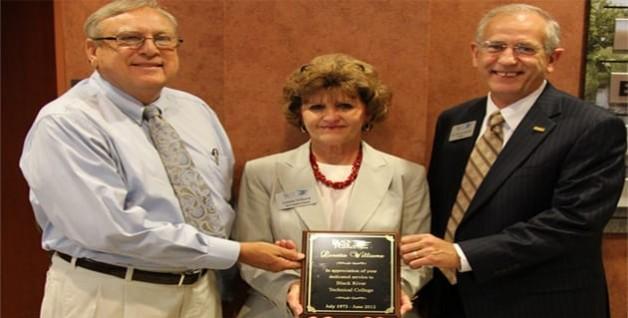 Retirement Reception Honors Four